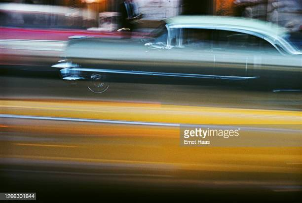 Streaks of colour in a long exposure shot of passing traffic in New York City, 1957.