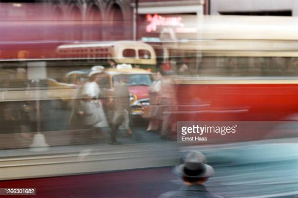 Streaks of colour in a long exposure shot of pedestrians and traffic in New York City, 1957.