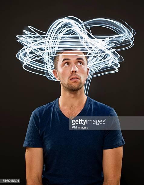 Streaks of light around man's head