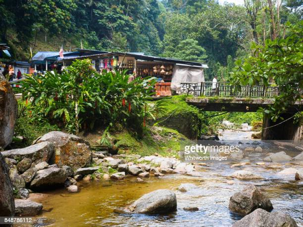 Stream, bridge and stalls at Iskandar Waterfall reserve, Perak, Malaysia