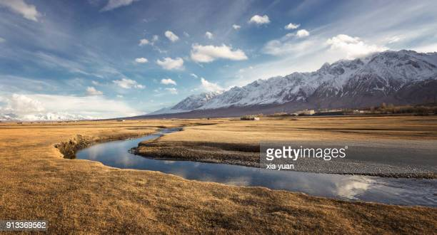 stream flowing through the grassland on the pamirs,tashkurgan,china - xinjiang province stock photos and pictures