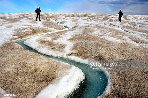 A stream made by the melting glacier is seen while the surface of the glacier is covered by cryoconite on July 17 2012 near Qaanaaq Greenland In...