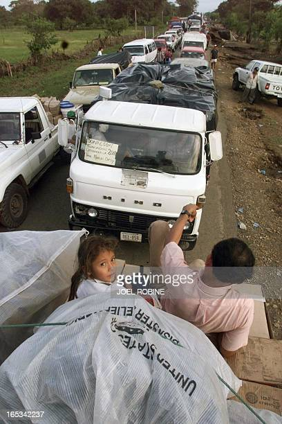 A stream of cars many of them loaded with food medecines and material for rescue operations move on a road in the Chichigalpa area in the northeast...