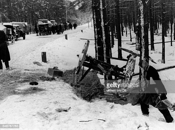 Stream of refugees from the eastern parts of Germany on a snowed in country road in Lusatia - February 1945