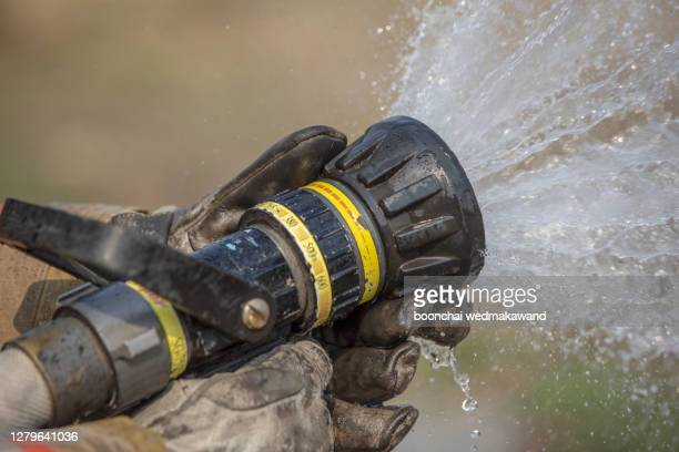 stream of water from a fire hose - 2010 stock pictures, royalty-free photos & images