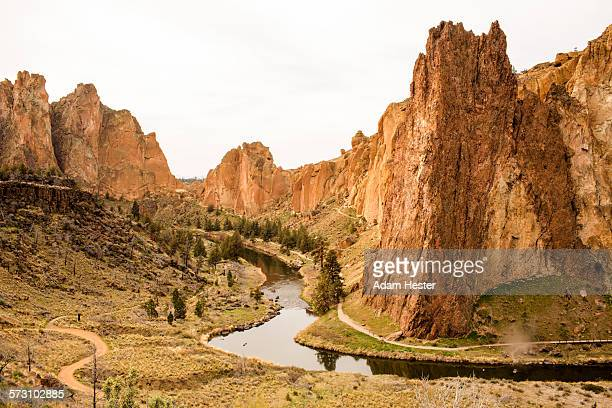 Stream through sheer cliffs in desert landscape, Smith Rock State Park, Oregon, United States