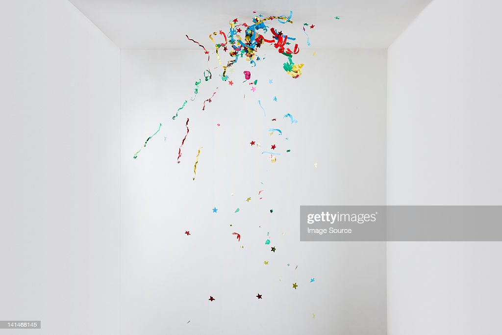 Streamers and confetti in mid air : Stock Photo