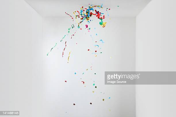 streamers and confetti in mid air - detonate stock photos and pictures