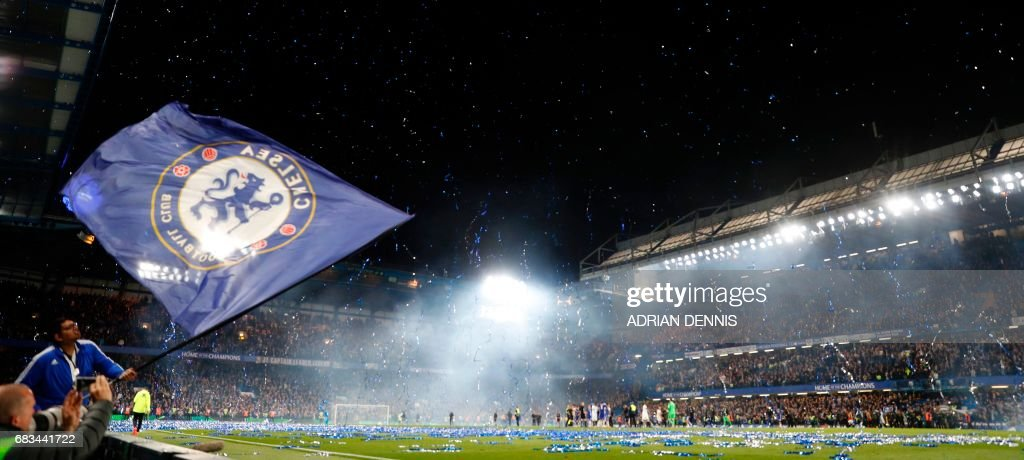 TOPSHOT - Streamers errupt over the pitch at the end of the English Premier League football match between Chelsea and Watford at Stamford Bridge in London on May 15, 2017. / AFP PHOTO / Adrian DENNIS / RESTRICTED TO EDITORIAL USE. No use with unauthorized audio, video, data, fixture lists, club/league logos or 'live' services. Online in-match use limited to 75 images, no video emulation. No use in betting, games or single club/league/player publications. /