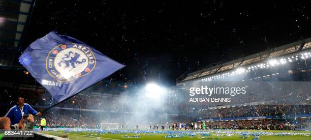 TOPSHOT Streamers errupt over the pitch at the end of the English Premier League football match between Chelsea and Watford at Stamford Bridge in...