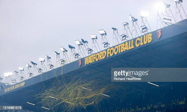 Streamers hang from floodlights during the Sky Bet Championship match between Watford and Swansea City at Vicarage Road on May 08, 2021 in Watford,...