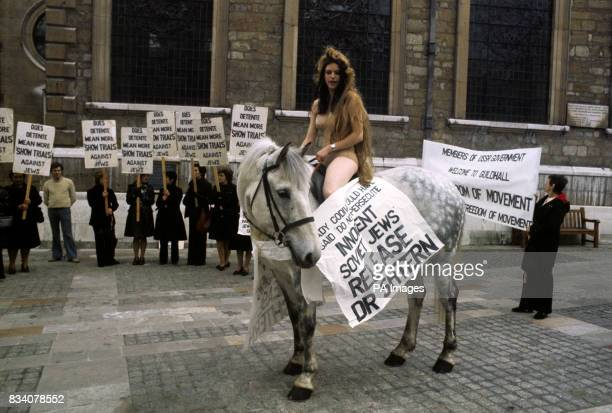 A streamlined Lady Godiva in the form of swimsuited shape of Mary Anne Thomas 17 of Caterham Surrey astride her horse Blue Streak outside the...