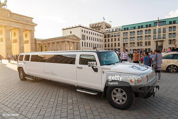 streching limousine hummer at brandenburger tor berlin - hummer stock photos and pictures