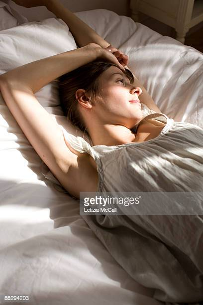 streching woman - waking up stock pictures, royalty-free photos & images