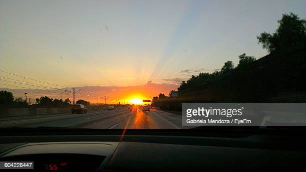 street against sky during sunset seen through windshield - compton california stock pictures, royalty-free photos & images