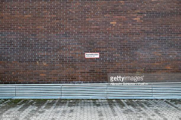 street against wall with text - albrecht schlotter stock photos and pictures