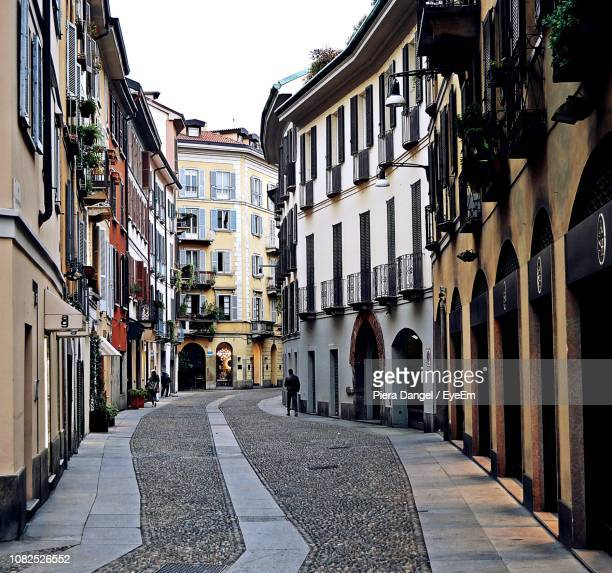 street amidst buildings against clear sky - lombardy stock pictures, royalty-free photos & images