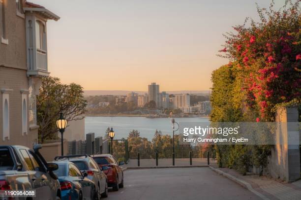 street amidst buildings against sky during sunset - perth australia stock pictures, royalty-free photos & images