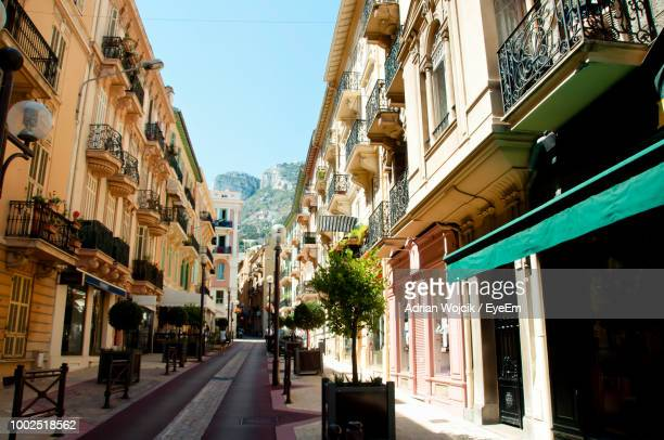 street amidst buildings against sky in city - monte carlo stock-fotos und bilder