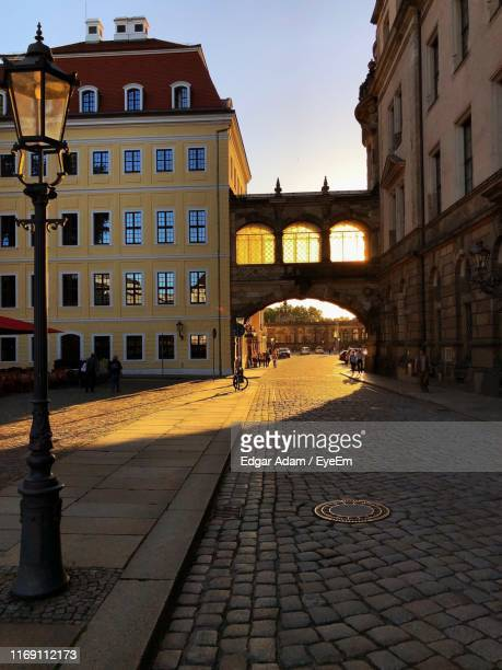 street amidst buildings against sky in city - green vault stock pictures, royalty-free photos & images