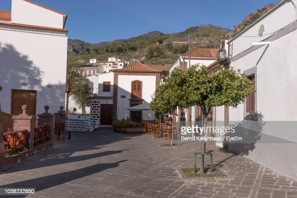 street amidst buildings against sky - tejeda stock pictures, royalty-free photos & images
