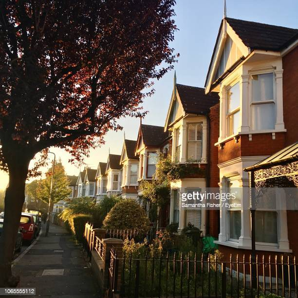 street amidst buildings against sky - terraced_house stock pictures, royalty-free photos & images