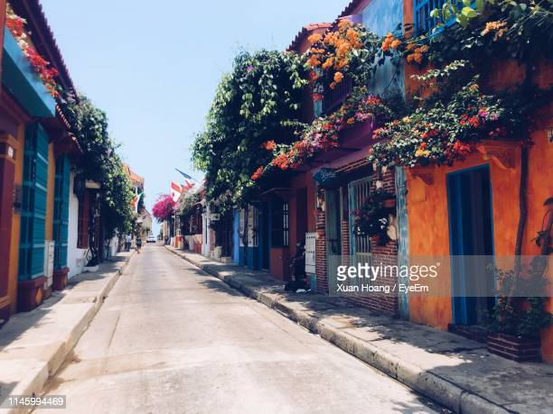 street amidst buildings in city against sky - cartagena colombia foto e immagini stock