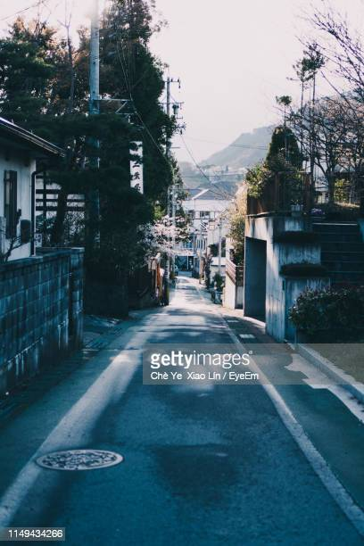 street amidst buildings in city against sky - 長野市 ストックフォトと画像