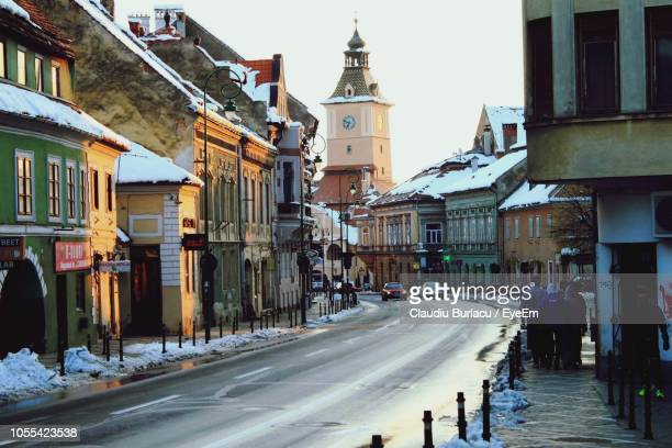 street amidst buildings in city during winter - transylvania stock pictures, royalty-free photos & images