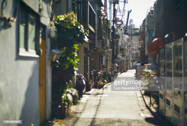 street amidst buildings in city - narrow stock pictures, royalty-free photos & images