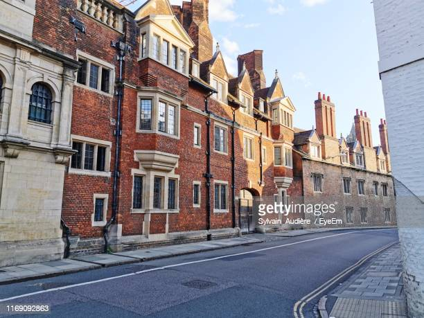 street amidst buildings in city - cambridge stock pictures, royalty-free photos & images