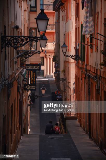 street amidst buildings in city - san sebastian spain stock pictures, royalty-free photos & images