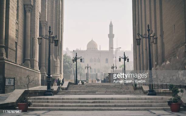 street amidst buildings in city - cairo stock pictures, royalty-free photos & images