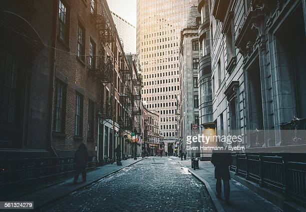 street amidst buildings in city - lower manhattan stock photos and pictures