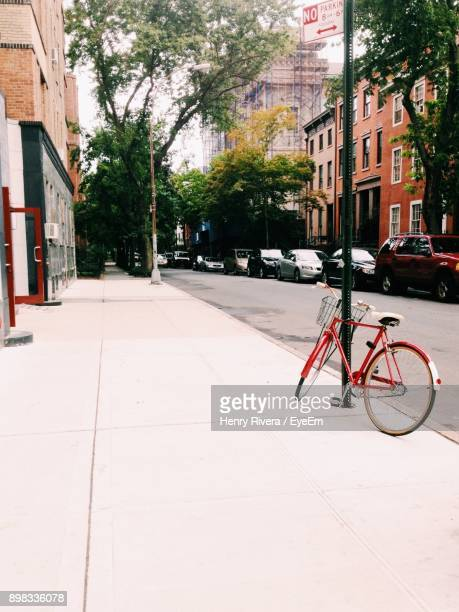 street amidst buildings in city - henry street stock pictures, royalty-free photos & images