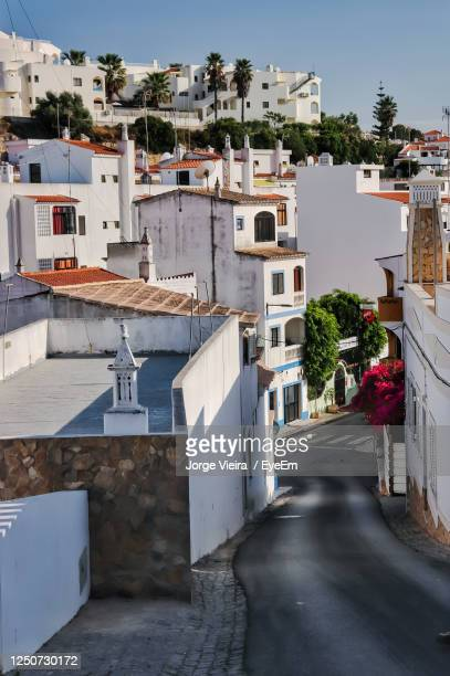 street amidst buildings in town against clear sky - faro district portugal stock pictures, royalty-free photos & images