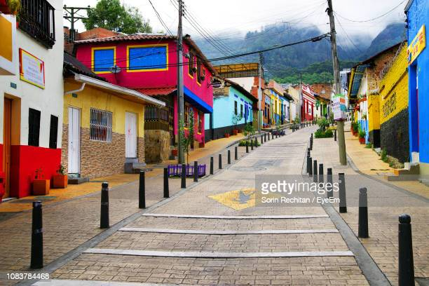 street amidst buildings in town against mountain - bogota stock pictures, royalty-free photos & images