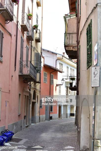 street amidst buildings in town - cuneo stock pictures, royalty-free photos & images