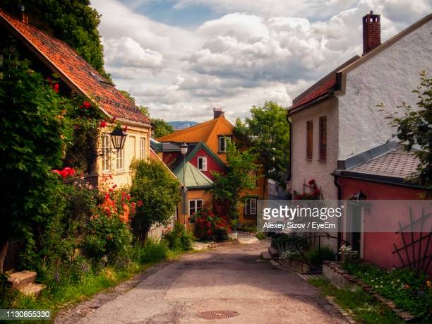 street amidst buildings in town - oslo stock pictures, royalty-free photos & images