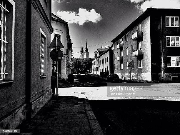 street amidst buildings leading towards church - ostrava stock pictures, royalty-free photos & images