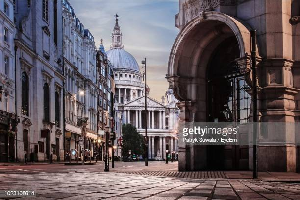 street amidst buildings leading towards st paul cathedral - cathedral stock pictures, royalty-free photos & images