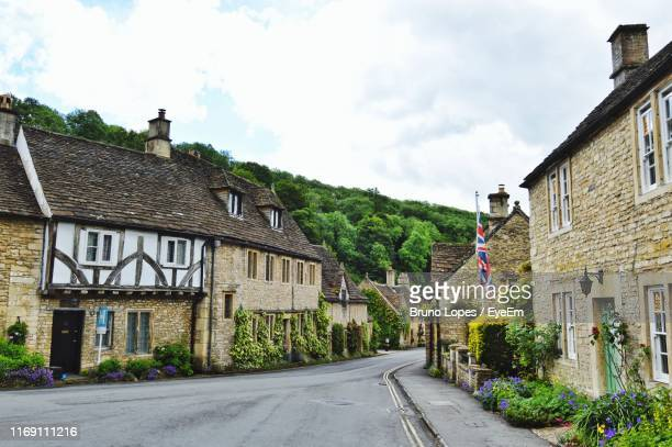 street amidst houses and buildings against sky - city gate stock pictures, royalty-free photos & images