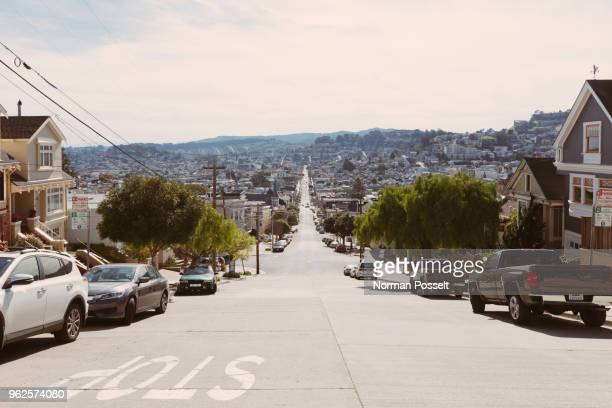 street amidst residential buildings in city, san francisco, california - california stockfoto's en -beelden