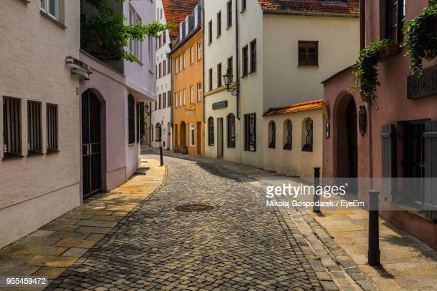 street amidst residential buildings - augsburg stock pictures, royalty-free photos & images