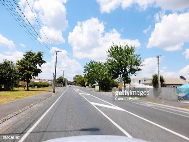 street amidst trees against sky - hamilton new zealand stock photos and pictures