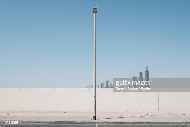street and buildings against clear blue sky - street light stock pictures, royalty-free photos & images