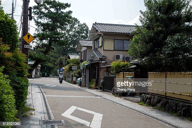 Street and country houses in Uji. In the Tale of Genji, a classic work of Japanese literature written in the early years of the 11th century around...