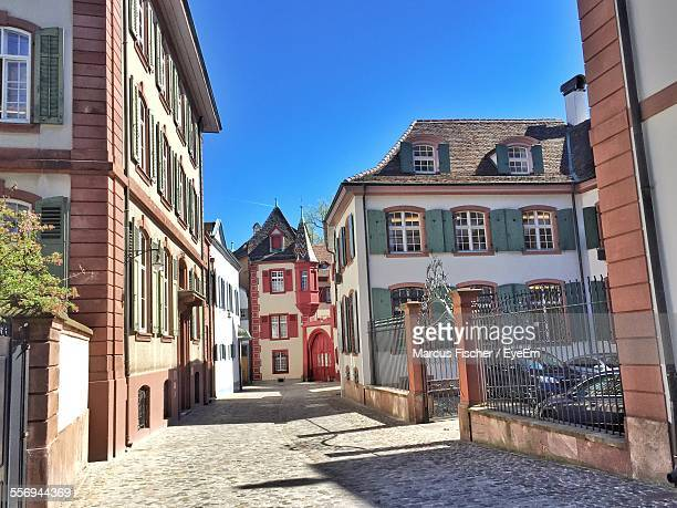 street and houses against clear blue sky - basel switzerland stock photos and pictures
