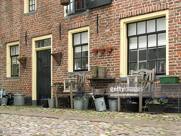 Street and part of historic house, Elburg, The Netherlands