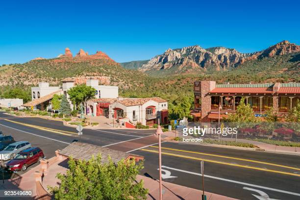 street and scenic mountains in uptown sedona arizona - sedona stock photos and pictures